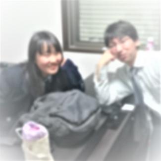 卒業生と一緒に撮影
